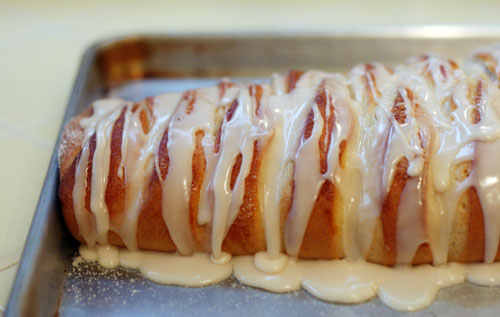Braided loaf of Swedish sweet yeast bread drizzled with vanilla glaze