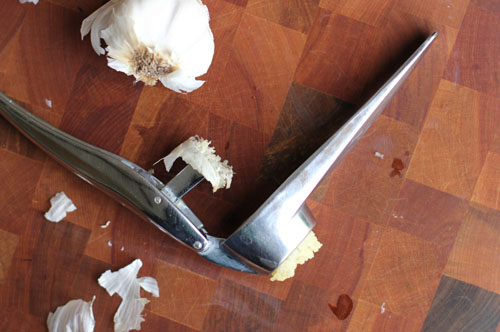 how to effectively use a garlic press | from @janemaynard at thisweekfordinner.com