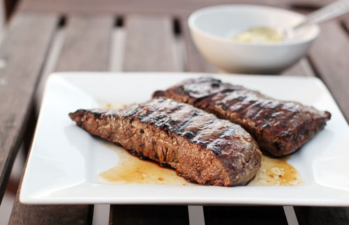 picture of grilled cooked steak on a white plate