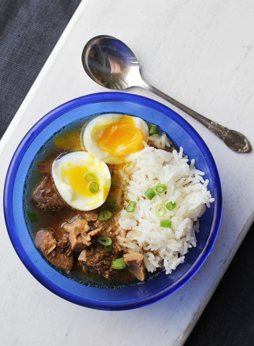 recipe for chicken kai pa lo, a thai soup with rice and soft-boiled eggs that is SCRUMPTIOUS from @janemaynard