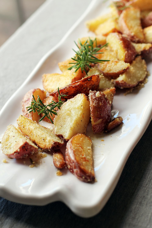 "recipe for crispy rosemary roast potatoes from the new cookbook ""brown eggs and jam jars"""