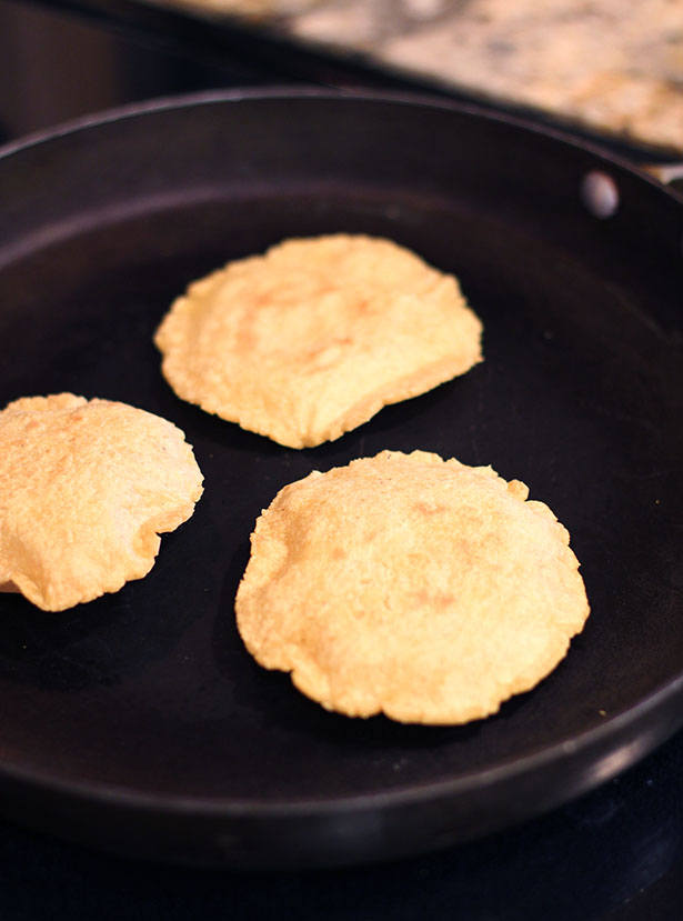 Fresh masa corn tortillas cooking in the pan