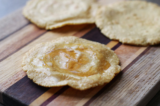 Homemade fresh masa tortilla with butter and honey