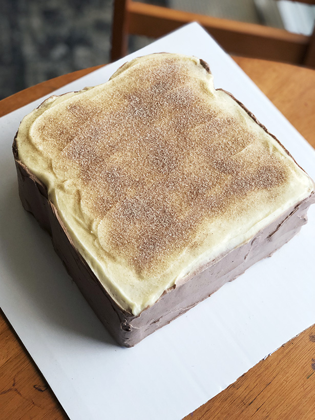 Birthday cake that looks like toast with cinnamon sugar on top!