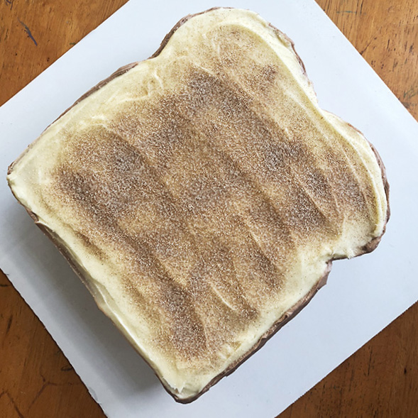 Top view of a birthday cake that looks like cinnamon sugar toast
