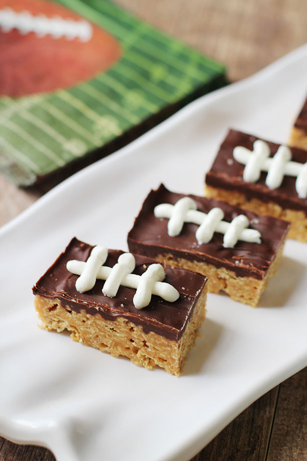 Side view of super cute football cashew Rice Chex treats