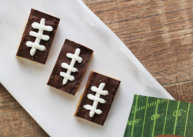 Top view of Football Cashew Rice Chex Treats, decorated with white frosting