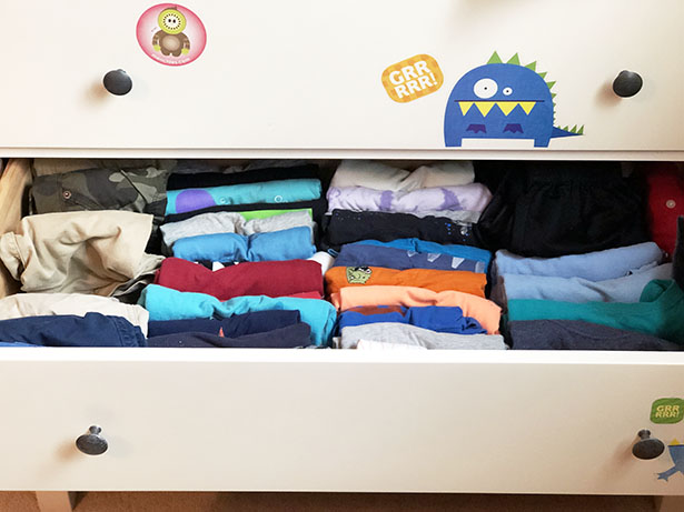 My son's t-shirt drawer, with all the clothes folded the Marie Kondo way