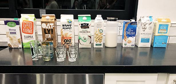 Line up of 10 different milk alternatives