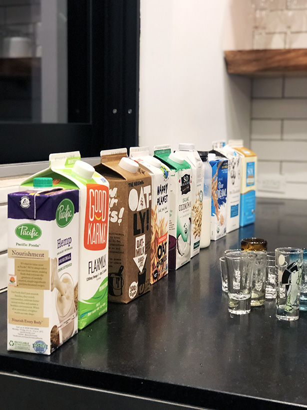 10 milk alternatives set up for a milk tasting party