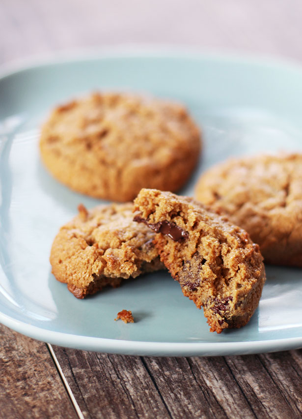 Gluten-Free Cashew Butter Cookies on a plate, broken open to show chocolate chips