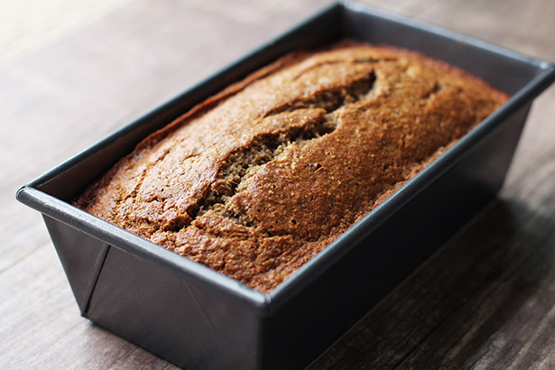 Side backlit view of gluten-free banana bread in pan