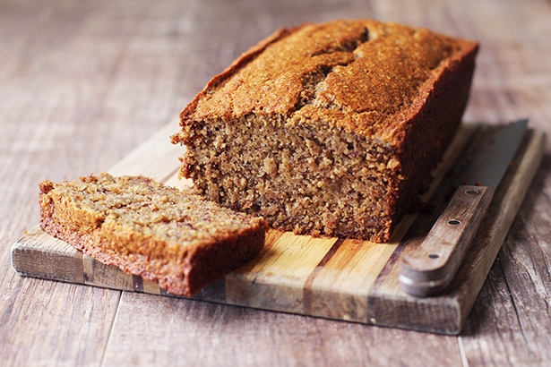 Gluten-Free banana bread on a cutting board sliced
