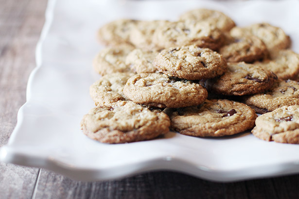 Plate of gluten-free oatmeal chocolate chip cookies, lit from the side