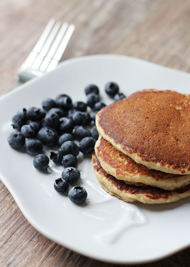 Banana Oat Pancakes on plate with blueberries, gluten-free and dairy-free recipe
