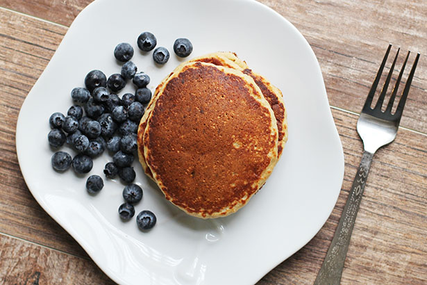 Top view of banana oat pancakes with blueberries, gluten-free recipe