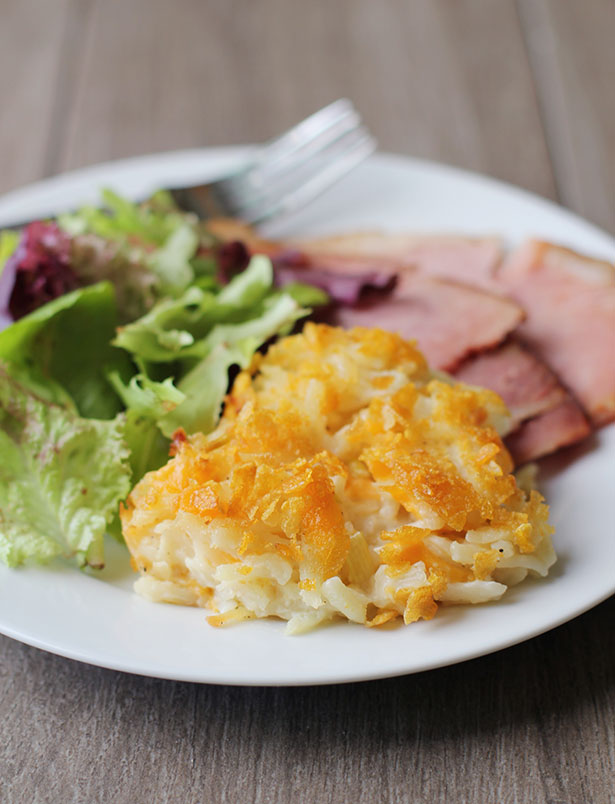 Funeral Potatoes, cheesy potato casserole, on a plate