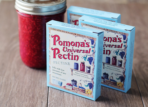 Boxes of Pomona's Universal Pectin in front of a jar of jam