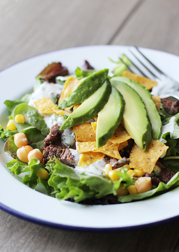 Carne asada salad with cilantro crema dressing