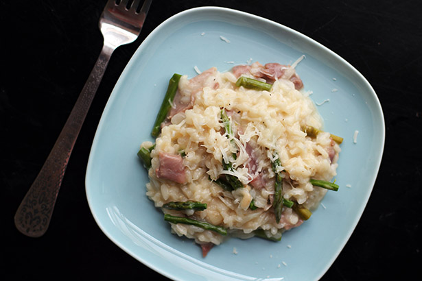 Top view of risotto with asparagus and prosciutto